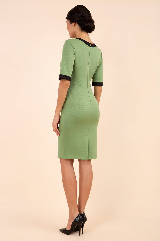 Model wearing the Diva Goggle pencil dress design in green with black, colour block detailing back image