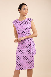 Brunette model wearing Diva Catwalk Perry Polka Dot Pencil Sleeveless Dress with tie detail on a side and rounded neckline in pink front