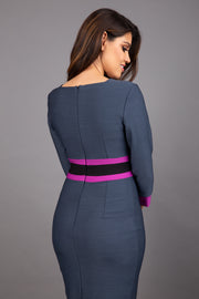 brunette model wearing Diva catwalk Paeonia dress square neckline with a vent in slate grey with dawn purple and black stripes around the waist and three quarter sleeve with dawn purple contrast finish back