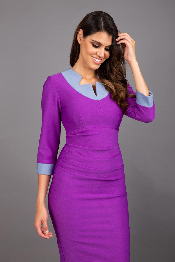 Model wearing Diva catwalk figure fitted pencil Cirrus dress in amethyst purple / steel grey, three quarter sleeve front image