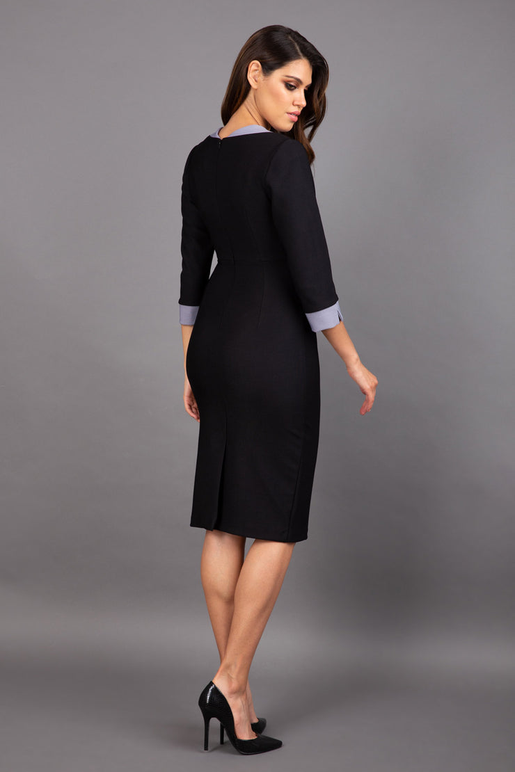 Model wearing Diva catwalk Cirrus figure fitted pencil dress in black/steel grey, three quarter sleeve back image
