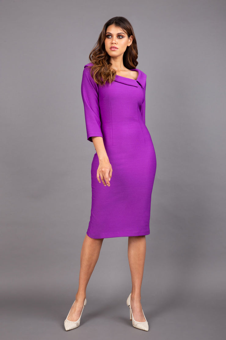 Model wearing Diva catwalk Opulus pencil dress in amethyst purple with three quarter sleeve figure fitted front image