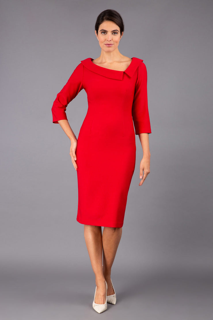 Model wearing Diva catwalk Opulus pencil dress in cardinal red with three quarter sleeve figure fitted front image