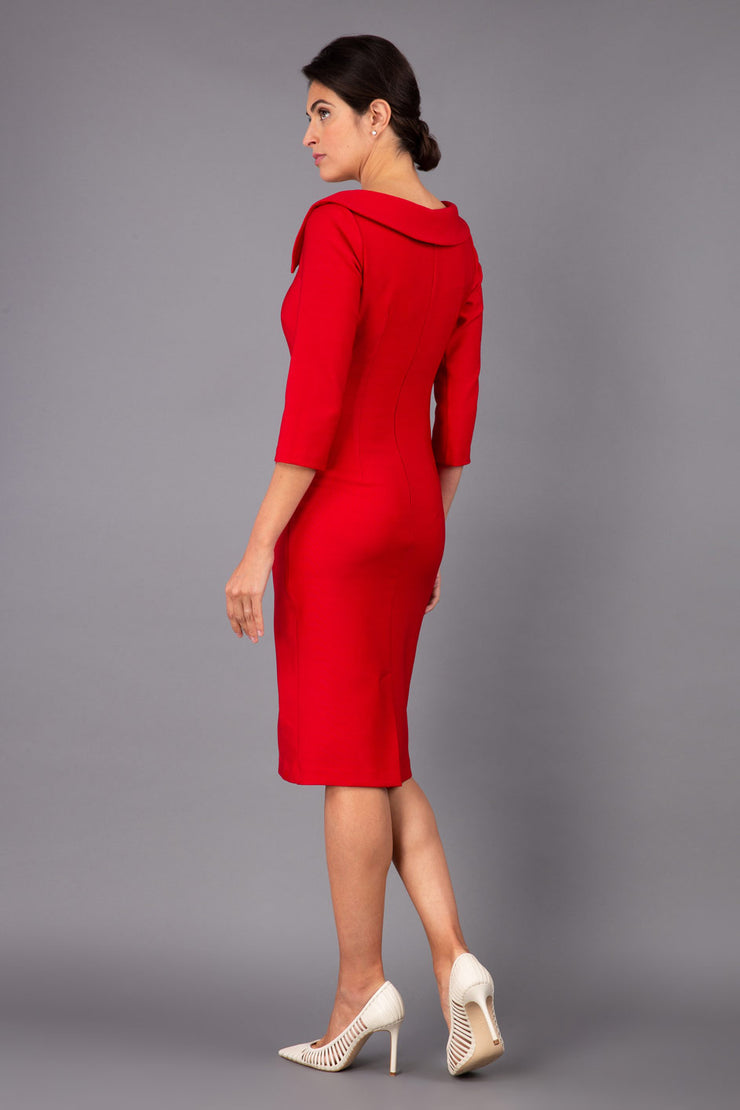 Model wearing Diva catwalk Opulus pencil dress in cardinal red with three quarter sleeve figure fitted back image