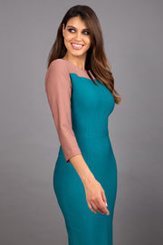 Model wearing Diva catwalk Katykat pencil figure fitted dress in pacific green and acorn brown detail with three quarter sleeve front image