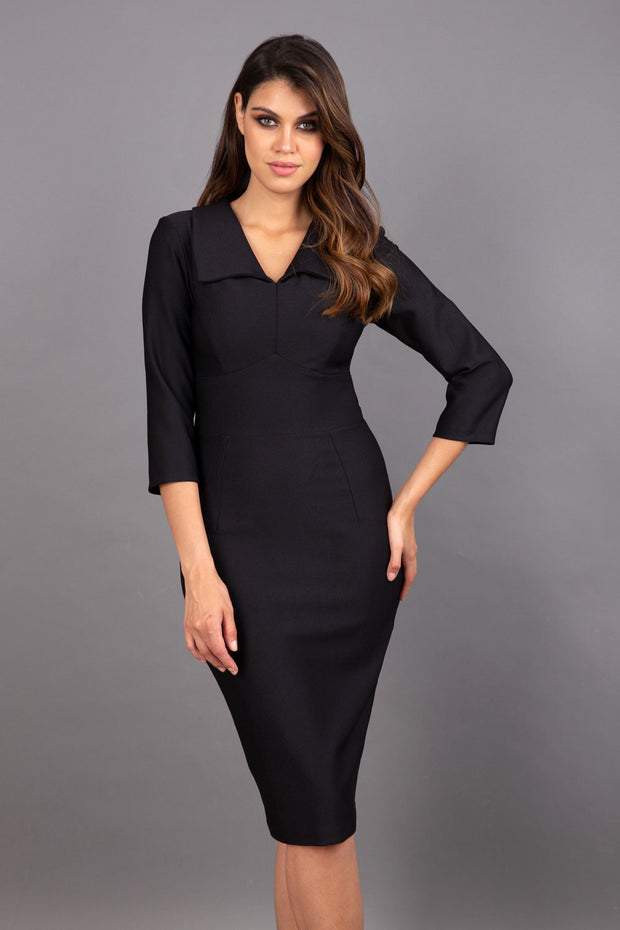 Model wearing Diva catwalk Pieris pencil dress in black with three quarter sleeve figure fitted front image
