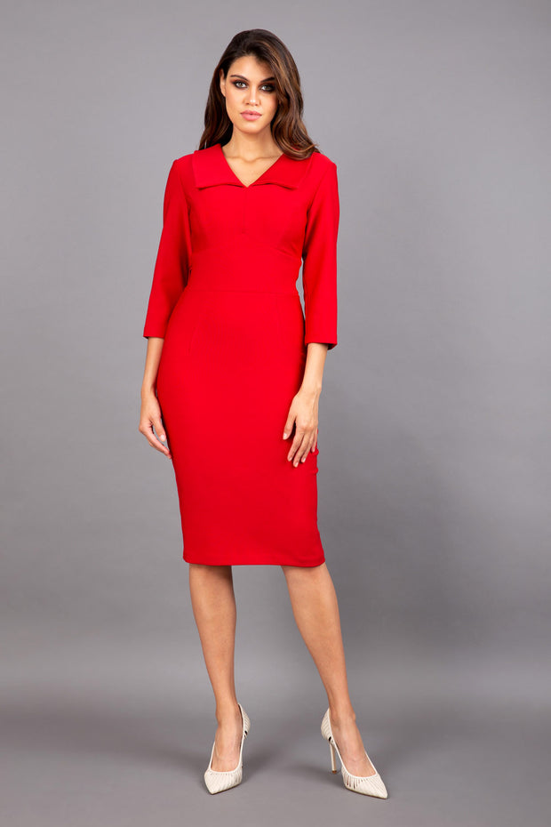 Model wearing Diva catwalk Pieris pencil dress in cardinal red with three quarter sleeve figure fitted front image