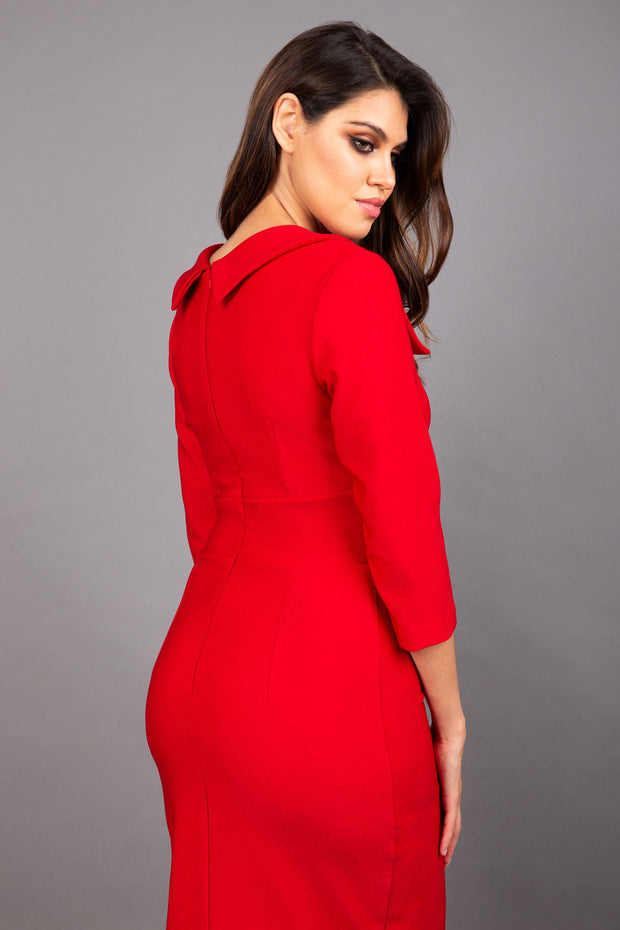 Model wearing Diva catwalk Pieris pencil dress in cardinal red with three quarter sleeve figure fitted back image