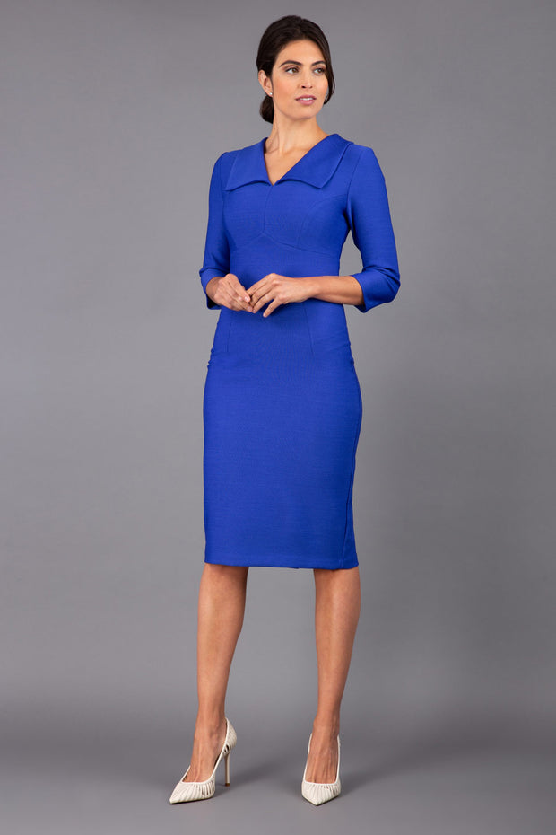 Model wearing Diva catwalk Pieris pencil dress in monaco blue with three quarter sleeve figure fitted front image