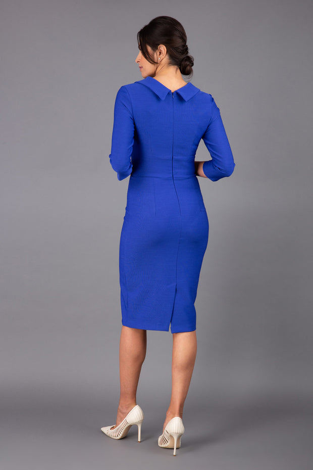 Model wearing Diva catwalk Pieris pencil dress in monaco blue with three quarter sleeve figure fitted black image