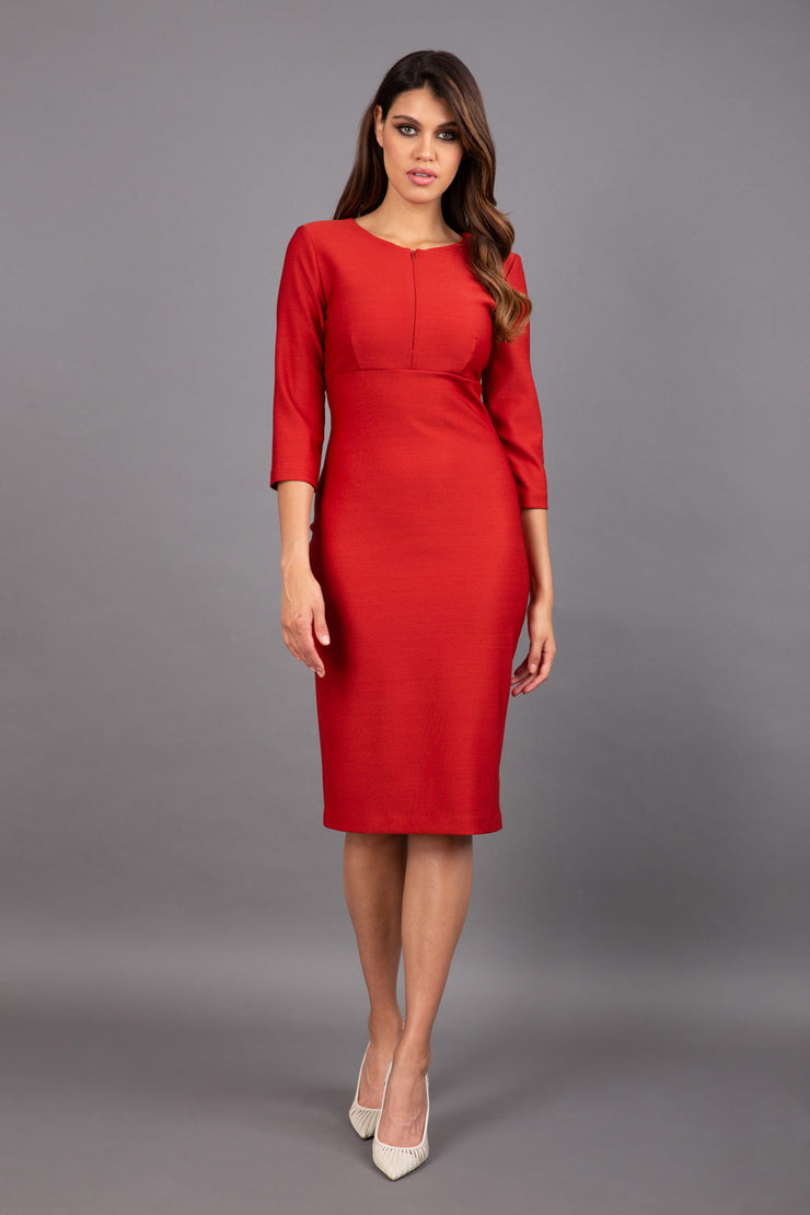 Model wearing Diva catwalk Minette dress in garnet red with three quarter sleeve figure fitted pencil dress front image