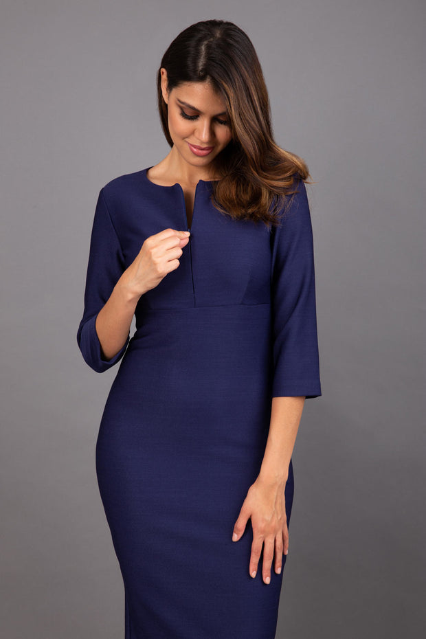 Model wearing Diva catwalk Minette dress in navy blue with three quarter sleeve figure fitted pencil dress front image