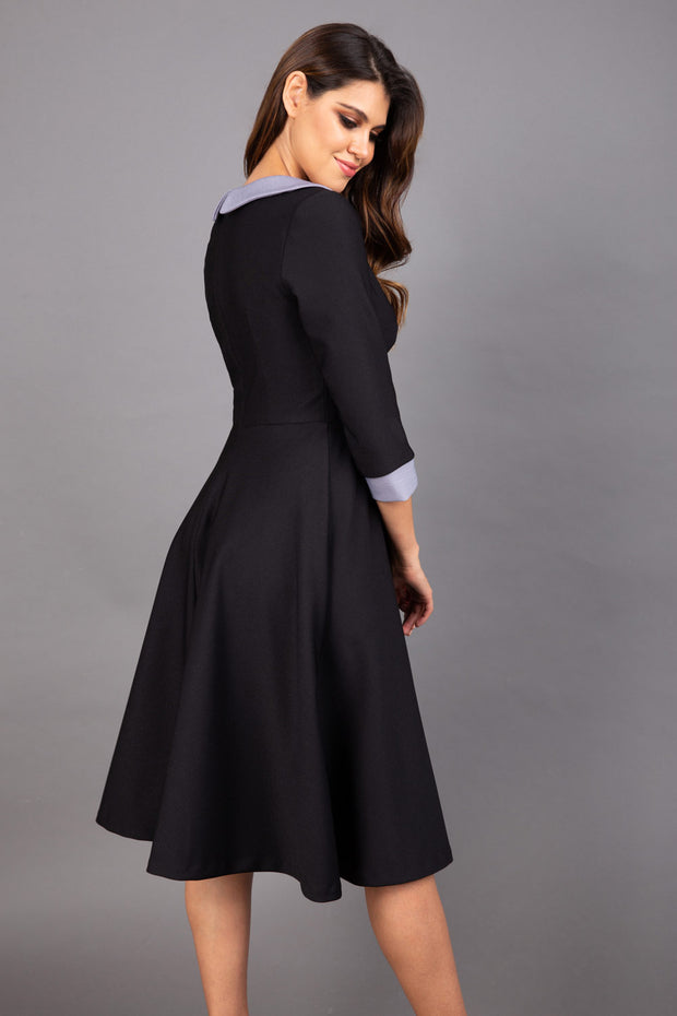 Model wearing Diva catwalk Coralia swing dress in black/ slate grey with three quarter sleeve figure fitted back image
