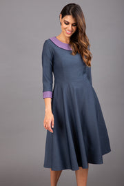 Model wearing Diva catwalk Coralia swing dress in slate grey/ lilac with three quarter sleeve figure fitted front image