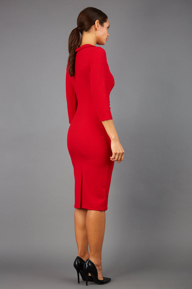 brunette model wearing diva catwalk elodie pencil fitted dress with rounded neckline and button detail and three quarter sleeve with pleating across the body from side triangle detail in scarlet red back