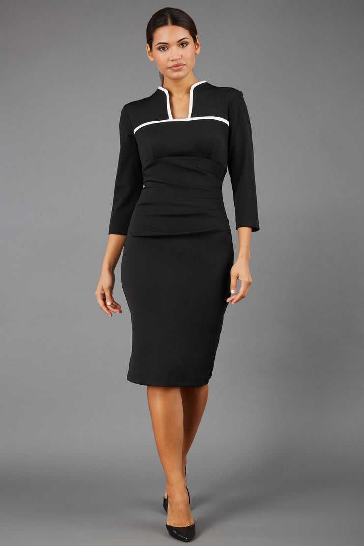 brunette model wearing diva catwalk masie little black dress with elizabethan collar and two-tone contrast neckline with 3 4 sleeves and is a pencil style dress front