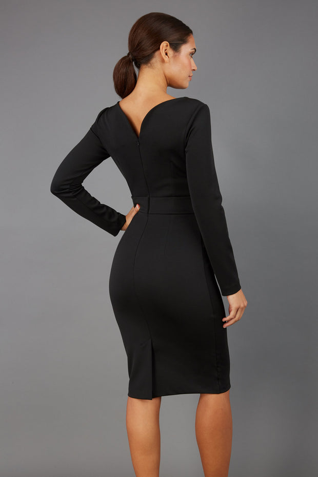 brunette model wearing diva catwalk tessa little black dress with boat neckline and long sleeves with a band back