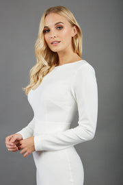 brunette model wearing diva catwalk tessa ivory cream dress with boat neckline and long sleeves with a band front