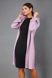 brunette model wearing diva catwalk hooded coat with long sleeves in soft cosy cashmere in pink front