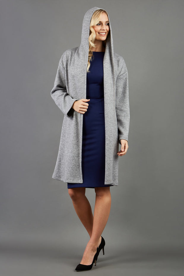 blonde model wearing diva catwalk hooded coat with long sleeves in soft cosy cashmere in grey front