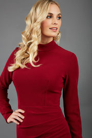 brunette model wearing diva catwalk sasha pencil-skirt dress with long sleeves and high neck in colour dark red  front