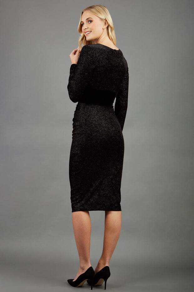 Blonde hair Model wearing 3/4 sleeve knee length glitter dress with velvet waistline back image