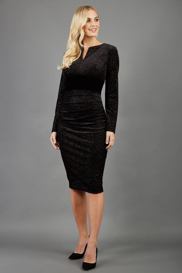 Blonde hair Model wearing 3/4 sleeve knee length glitter dress with velvet waistline