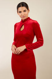 brunette model wearing diva catwalk clipper pencil skirt dress velvet sleeved style with a keyhole detail and high neck and split on a side of the skirt in colour red front