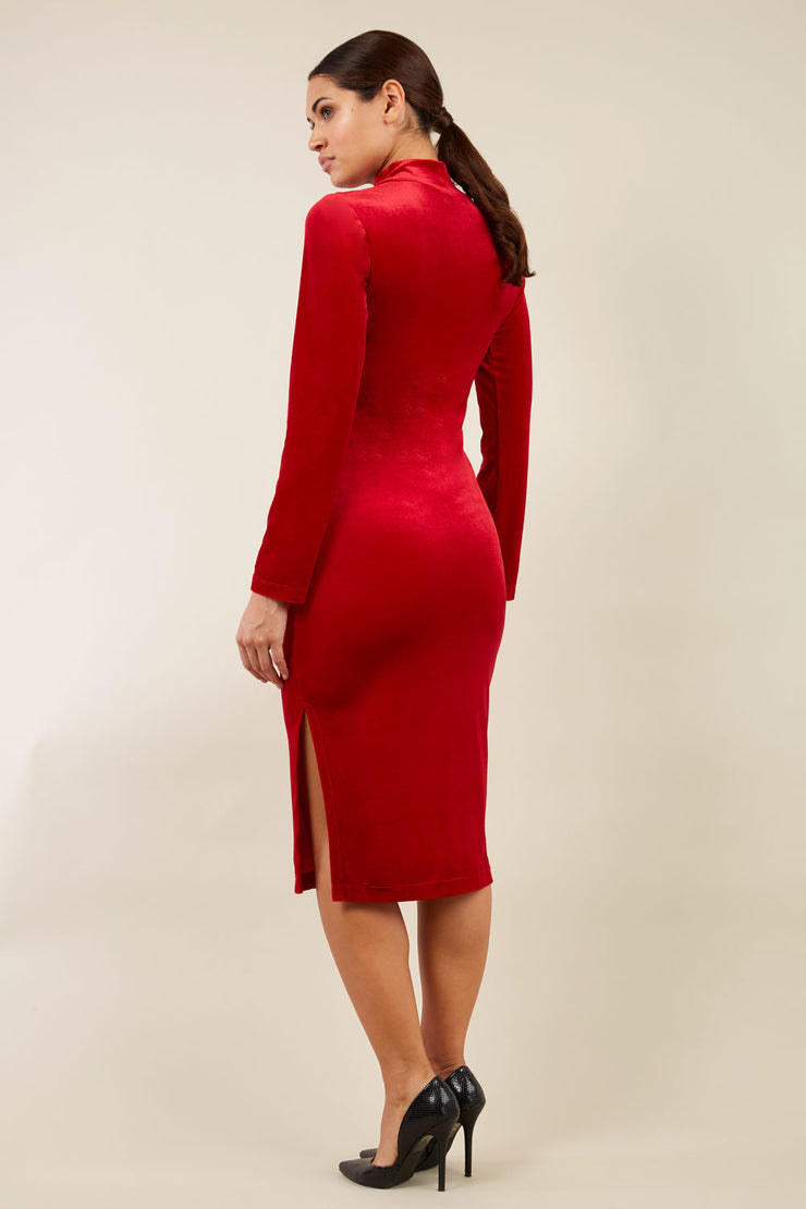 brunette model wearing diva catwalk clipper pencil skirt dress velvet sleeved style with a keyhole detail and high neck and split on a side of the skirt in colour red back