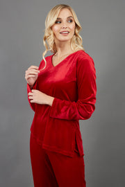 blonde model wearing diva catwalk dahlia asymmetric velvet top with sleeves in red front