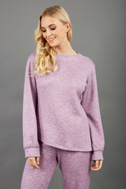 blonde model wearing diva catwalk muscari asymmetric sleeved top with rounded neck in pink front