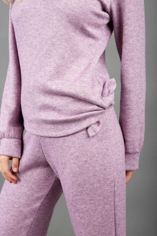 Model is wearing diva catwalk brody cashmere trousers long leg in lavender pink colour front paired with diva pink top