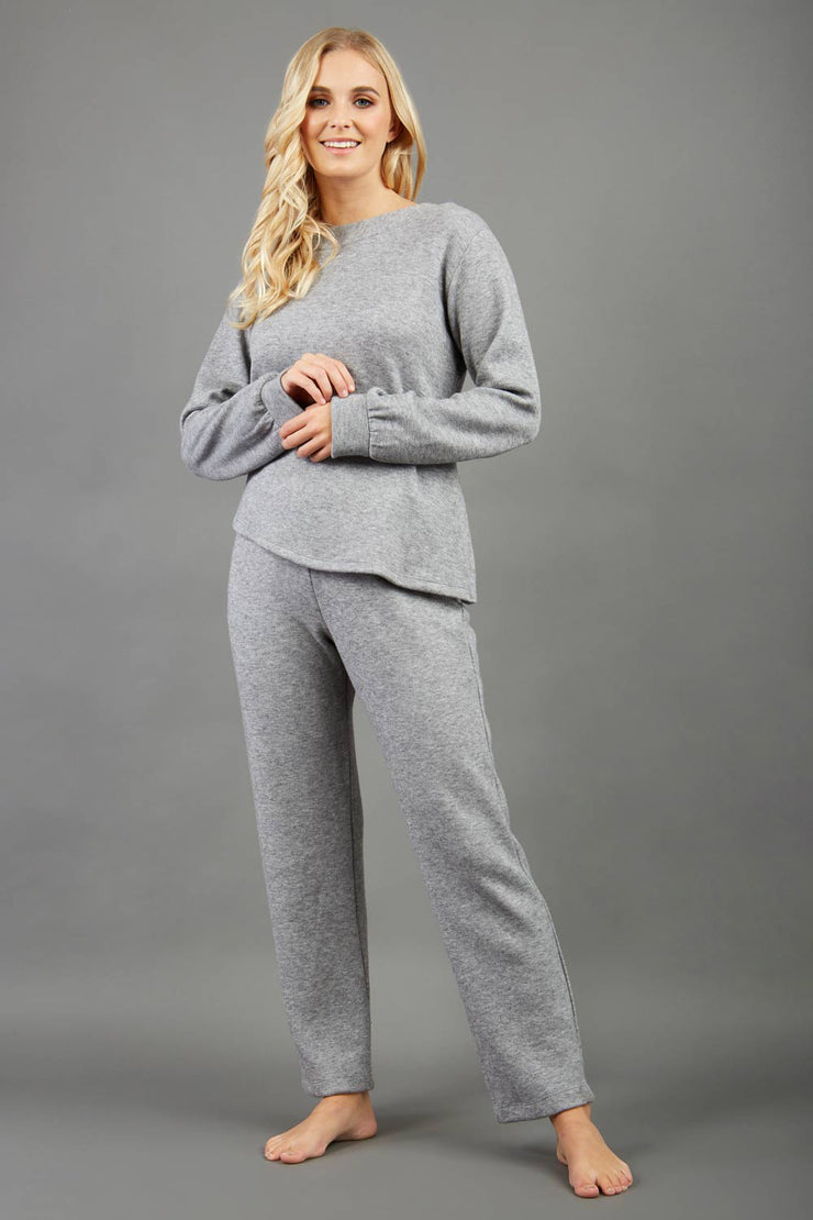 Model is wearing diva catwalk brody cashmere trousers long leg in flint grey colour front paired with diva long sleeve grey top