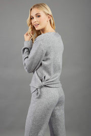 Model is wearing diva catwalk brody cashmere trousers long leg in flint grey colour back paired with diva long sleeve top
