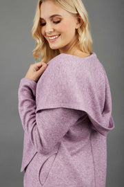 blonde model wearing diva catwalk cashmere hooded jacket with long sleeves and front waterfall closure in lavender mist back