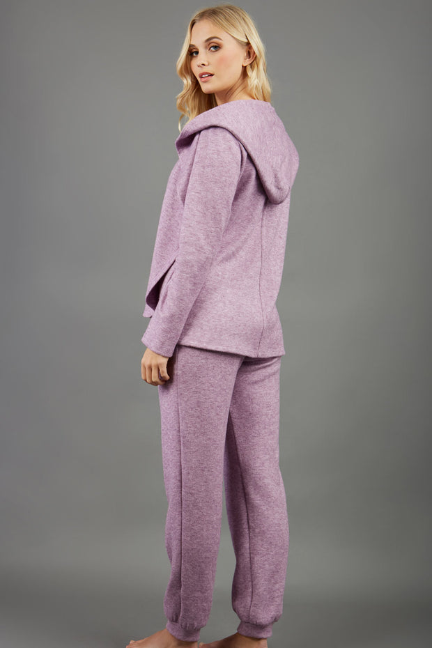 blonde model wearing diva catwalk cashmere hooded jacket with long sleeves and front waterfall closure in lavender mist back with cosy joggers matching the jacket