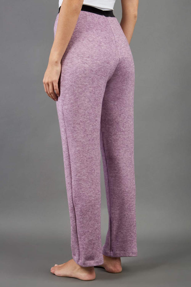 Model is wearing diva catwalk brody cashmere trousers long leg in pink colour back