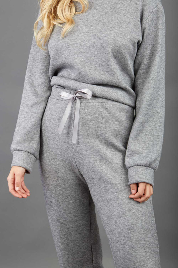 model wearing diva catwalk cosy soft touch cashmere joggers long leg with ribbon detail in flint grey sweat pants design front