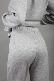 model wearing diva catwalk cosy soft touch cashmere joggers long leg with ribbon detail in flint grey back