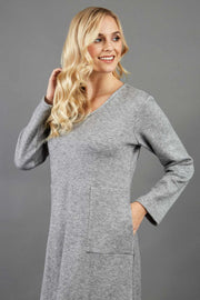 blonde model wearing diva catwalk irena cosy sleeved knee length dress with pockets and v-neckline in soft fabric grey front