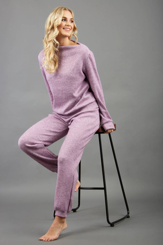 blonde model wearing diva catwalk hudson top with long sleeves and boat neckline in very soft cosy cashmere fabric in pink colour front with aria joggers matching the top front