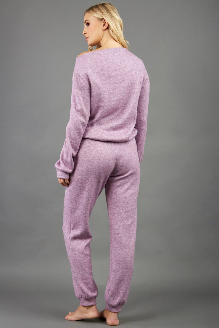 blonde model wearing diva catwalk hudson top with long sleeves and boat neckline in very soft cosy cashmere fabric in pink colour front with aria joggers matching the top back