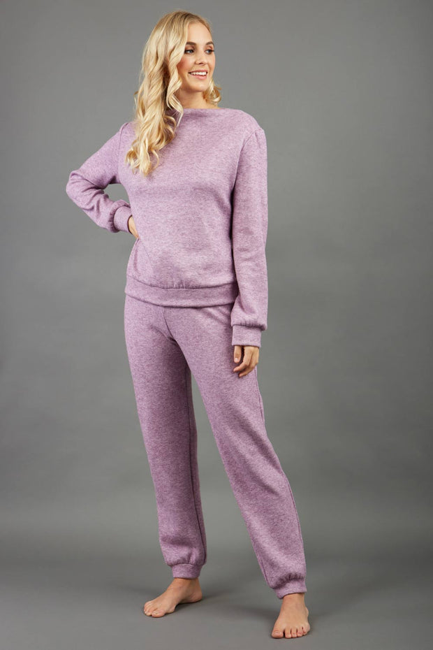 blonde model wearing diva catwalk hudson top with long sleeves and boat neckline in very soft cosy cashmere fabric in pink colour front with aria joggers marching the top front