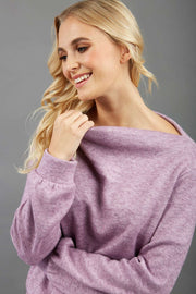 blonde model wearing diva catwalk hudson top with long sleeves and boat neckline in very soft cosy cashmere fabric in pink colour front