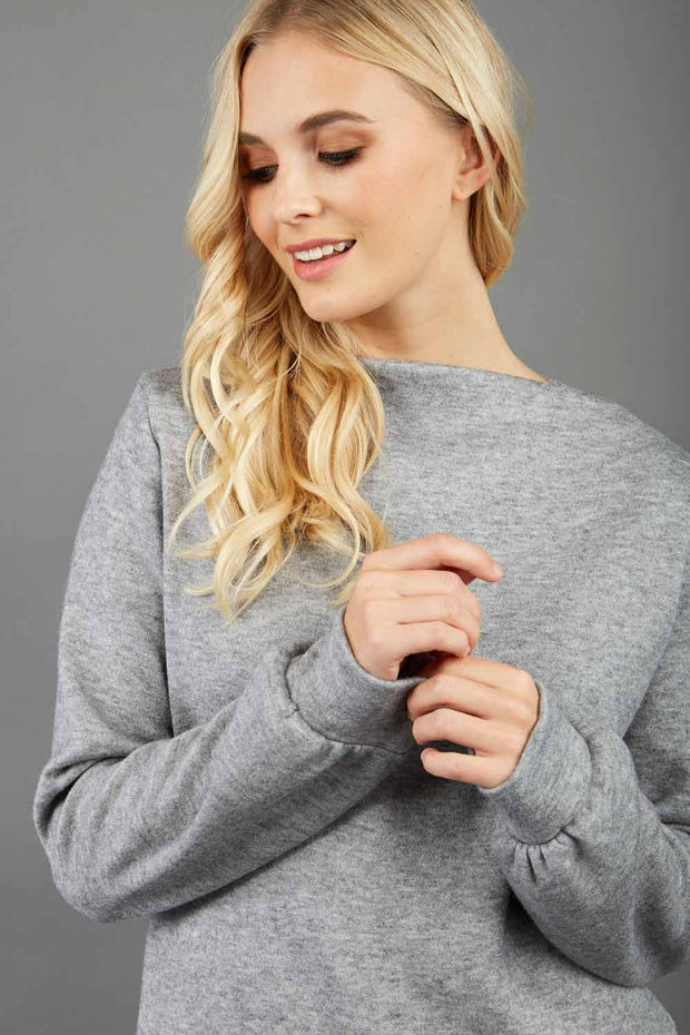 blonde model wearing diva catwalk hudson top with long sleeves and boat neckline in very soft cosy cashmere fabric in grey colour front