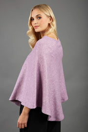 blonde model wearing diva catwalk rosalia poncho made in very cosy soft cashmere fabric in pink side