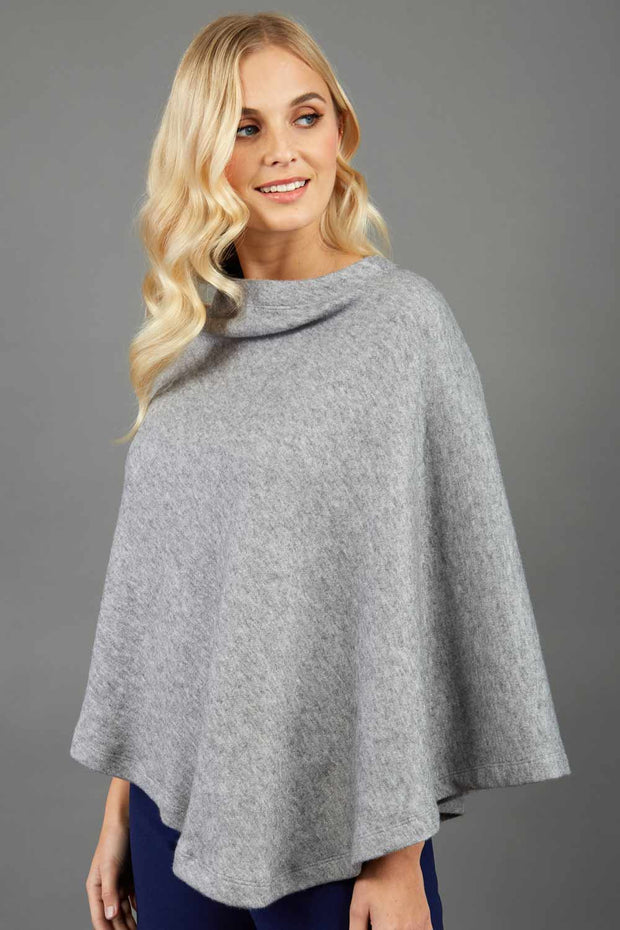 blonde model wearing diva catwalk rosalia poncho made in very cosy soft cashmere fabric in flint grey front