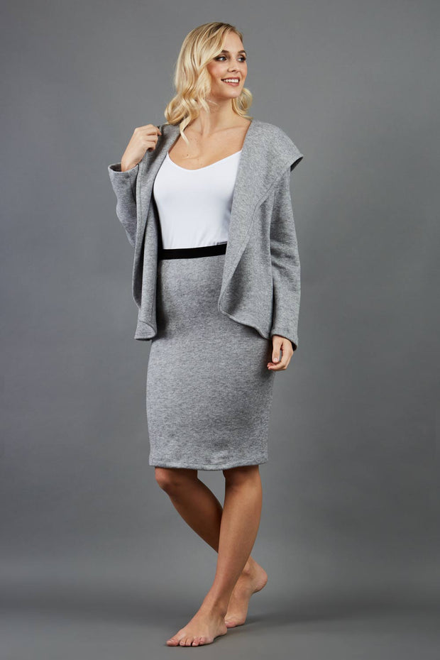 model is wearing diva catwalk elvira pencil grey skirt in soft cashmere fabric front paired with long sleeve top