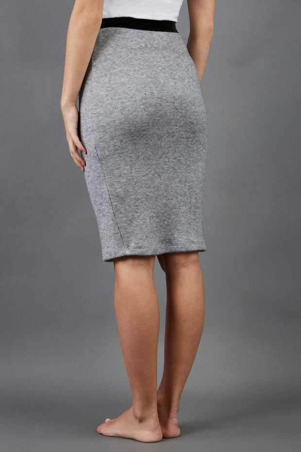 model is wearing diva catwalk elvira pencil grey skirt in soft cashmere fabric back