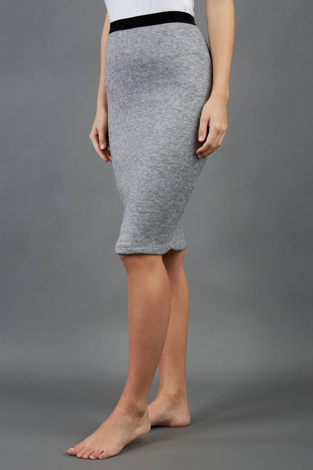 model is wearing diva catwalk elvira pencil grey skirt in soft cashmere fabric front